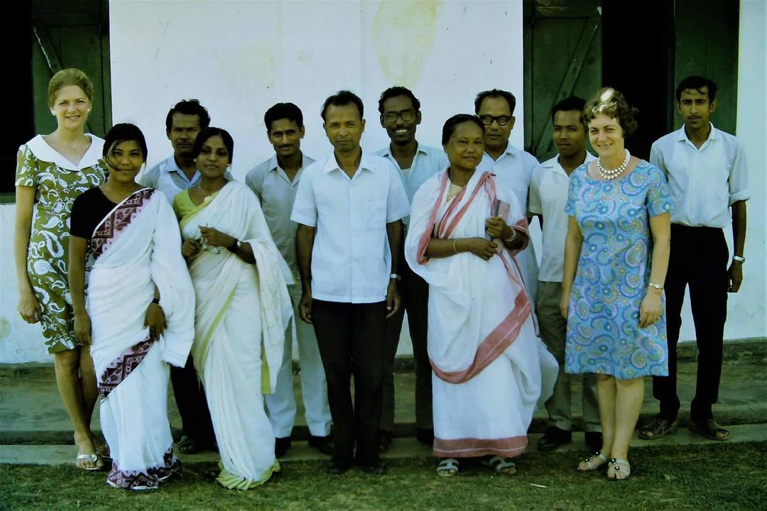 Headmaster Lalbulliana Rokhum( white shirt in centre)  From left- Elizabeth Jones, Syamali, Ronen, Puspa, Surajit, Bholanath De, Lalbul, Subhashstri, Subhash, ? , Dawn Fox, ? .